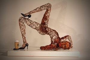 Sculpture of a human figure made with wires